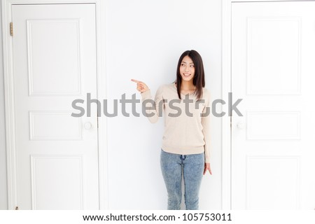 attractive asian woman with two doors