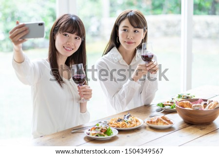 attractive asian women enjoying lunch in living room #1504349567