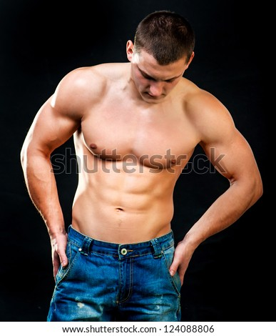 attractive athletic man on a black background