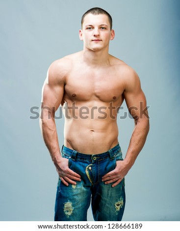 attractive athletic man on a gray background