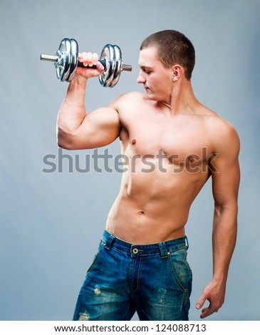 attractive athletic man with dumbbells in hand