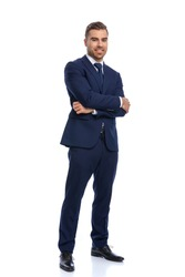 attractive bearded guy in elegant suit crossing arms and smiling, standing and posing isolated on white background in studio, full body