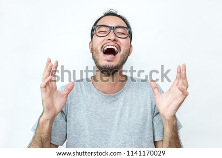 Attractive beautiful smiling positive nerd asian japanese happy man. Closeup portrait asian laughing nerdy boy wearing gray t-shirt isolated on white background.