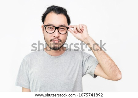 Attractive beautiful smiling positive nerd man. Close up portrait asian beard hairy nerdy man wearing glasses isolated on white background.