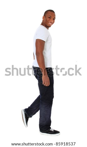 Attractive black man walking. All on white background.