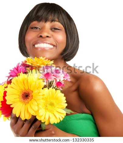 Attractive black smiling model holding fresh wildflower bouquet isolated on white background