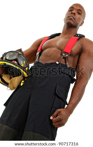 Attractive black thirty something male firefighter in uniform over white background.
