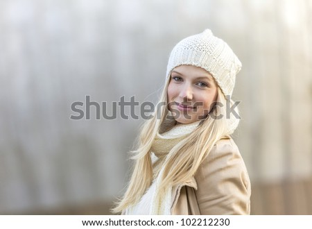 Attractive blond girl in winter - stock photo