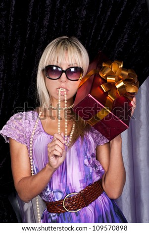 Attractive blond girl with a present