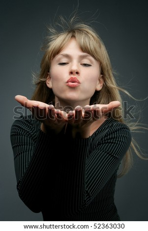 attractive blond is blowing a kiss