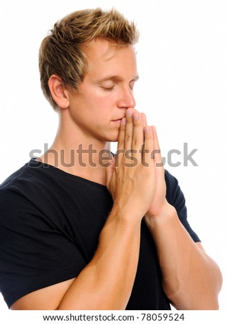 Attractive blond man clasps his hands together to pray, isolated on white