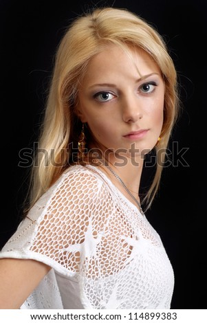 Attractive blond over black background
