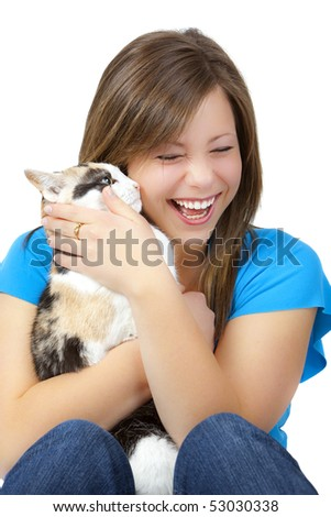 Attractive blond teen with a cat, laughing.