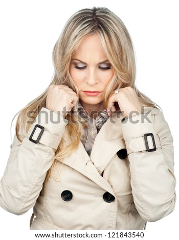 attractive blond woman making sad facial expression isolated