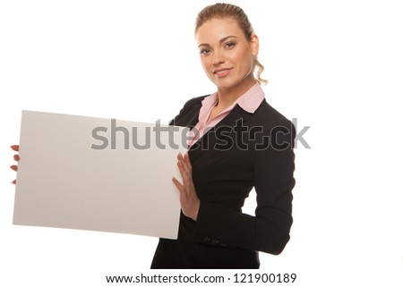 Attractive blonde business woman in dark suit holds a blank whit card with space for your text