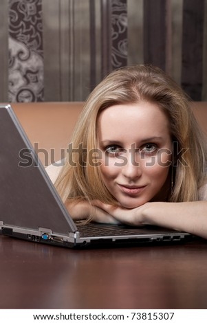 Attractive blonde girl with a laptop