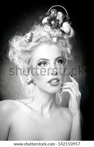 attractive blonde girl with fashion hair-style with mushrooms.Luxuriant . Femininity. Fashion Model with mushrooms in her hair.Glamorous female. Luxury coiffure and make up