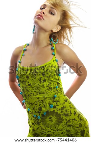 Attractive blonde in a green dress. Isolated on white.