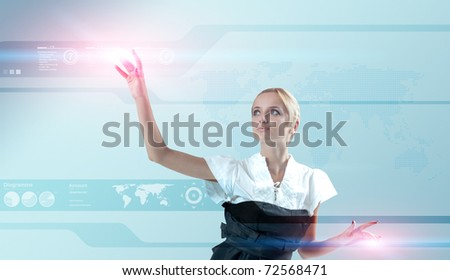 Attractive blonde touching the world map virtual future interface. Light flashes. One of a 200+ series.