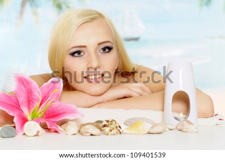 Attractive blonde with a bright appearance is resting at a resort