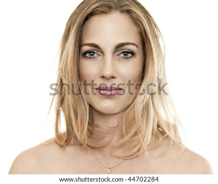 Attractive blonde with blue eyes and bare shoulders, looking at the camera.