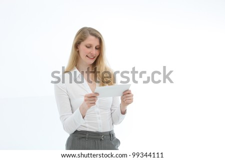 Attractive blonde woman concentrating while reading a letter she is holding in her hands isolated on white