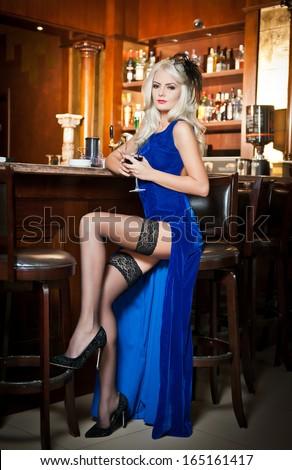 Nude girl sitting on bar stool all