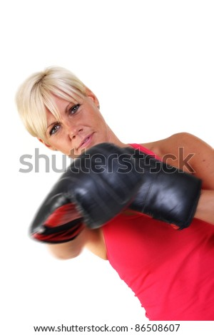 Attractive blonde woman keeping fit by shadow boxing