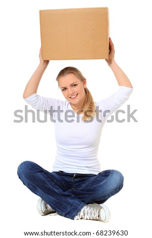 Attractive blonde woman lifting moving box. All on white background. - stock photo