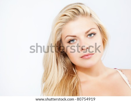 Attractive blonde woman portrait on white background