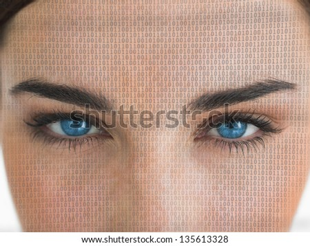 Attractive blue eyed woman with binary coding on face close up staring at camera