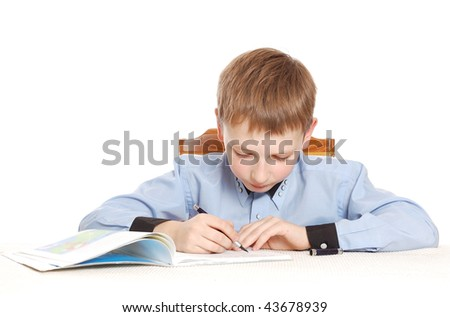 attractive boy make his homework isolated on white