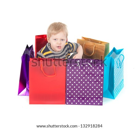 attractive boy with shopping bags  isolated on white background.