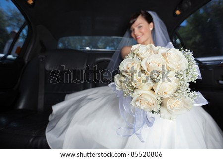 Attractive bride showing off her flower bouquet