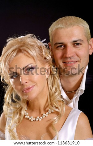 Attractive bride with perfect hair in a white dress with her groom