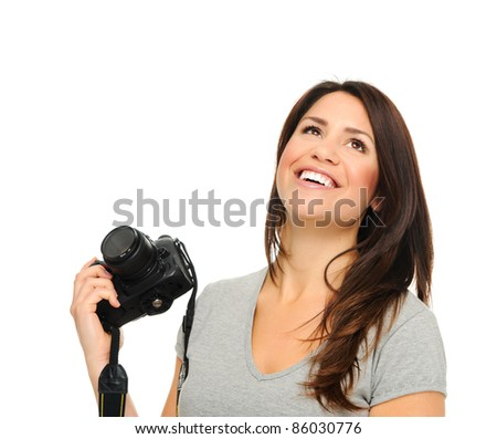 Attractive brunette holding and posing with  DSLR camera in studio, isolated on white