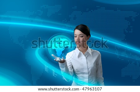 Attractive brunette holding virtual globe (outstanding business people in interiors / interfaces series) - stock photo