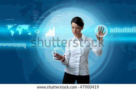 Attractive brunette navigating futuristic interface (outstanding business people in interiors / interfaces series)
