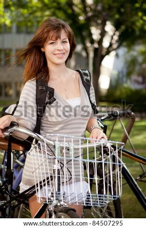 Attractive brunette student with retro bike
