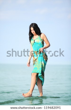 attractive brunette walking on water
