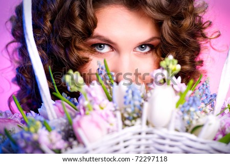 Attractive brunette with a bouquet of flowers close-up