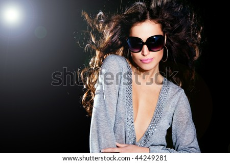 attractive brunette with sunglasses portrait