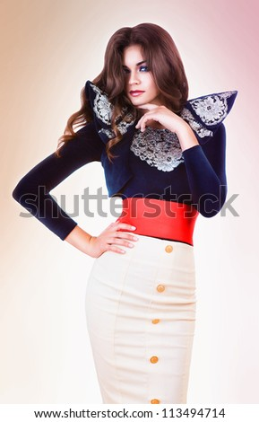 attractive brunette woman in jacket with laces and red belt