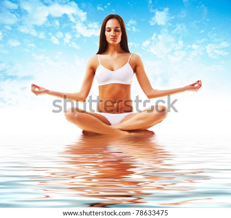 attractive brunette woman in yoga poseattractive brunette woman in yoga pose and sky