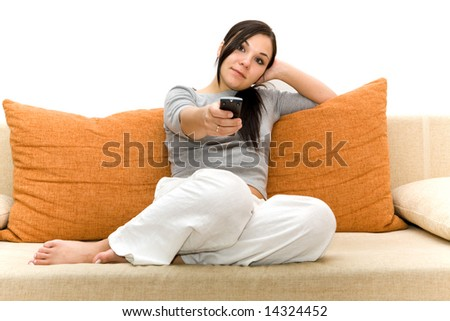 attractive brunette woman on sofa watching tv