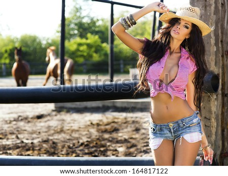 Attractive brunette woman posing wearing sexy clothes, sunny day.