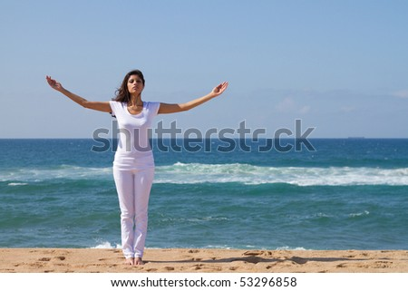 attractive brunette woman relaxing on the beach