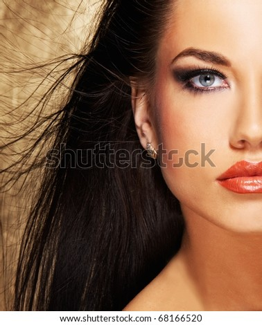 Attractive brunette woman with blowing hairs