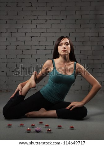Attractive brunette young woman doing yoga