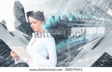 Attractive business lady working on tablet    . Mixed media